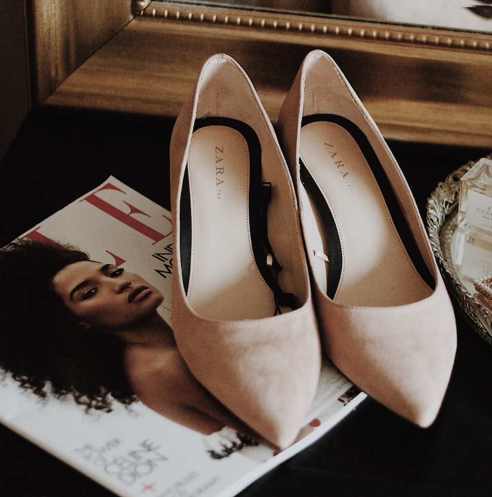 pair of beige suede stiletto shoes