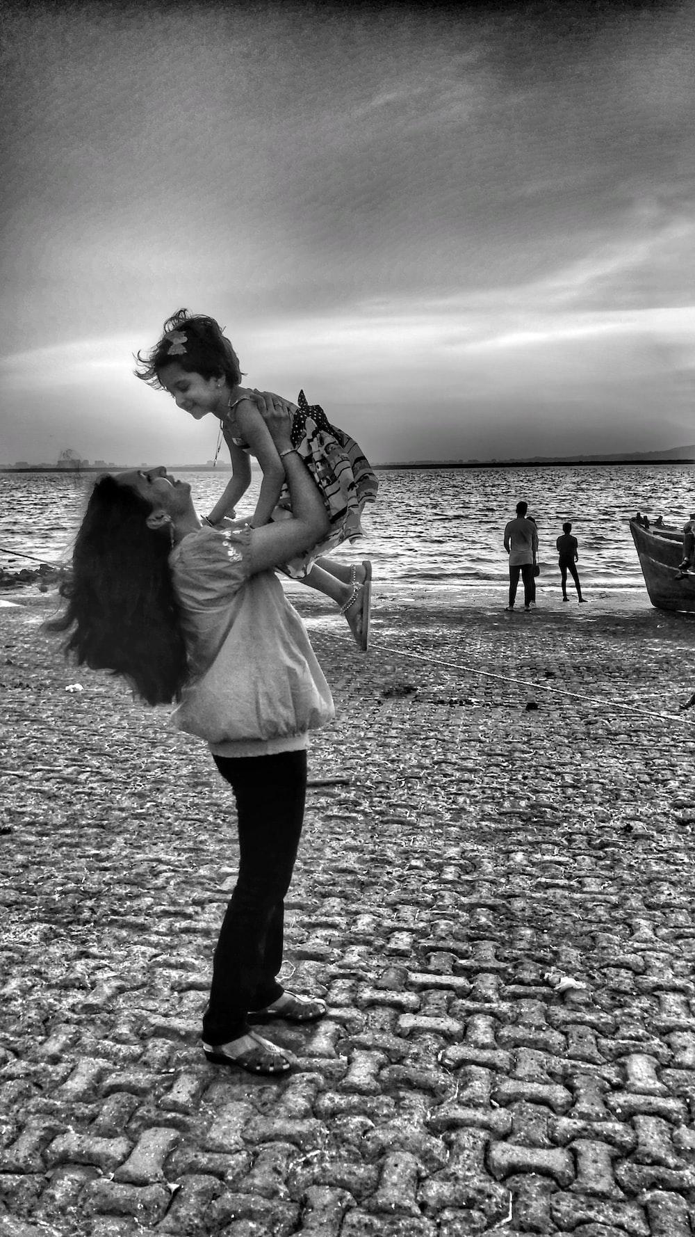 woman carrying girl