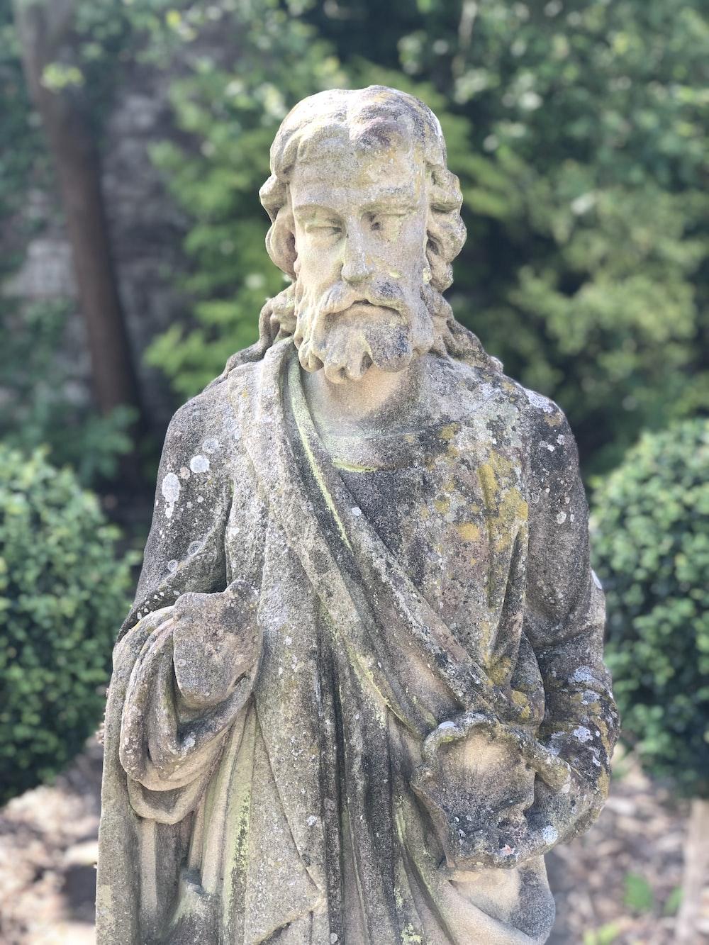 shallow focus photo of religious statue