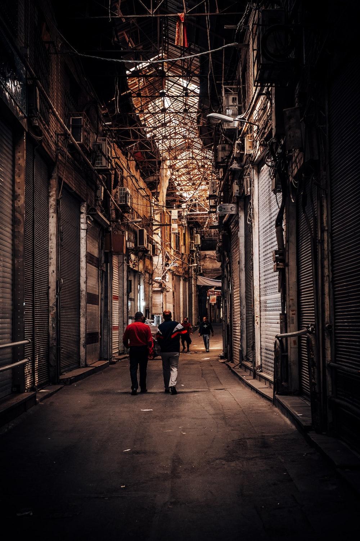 two men walking on streets