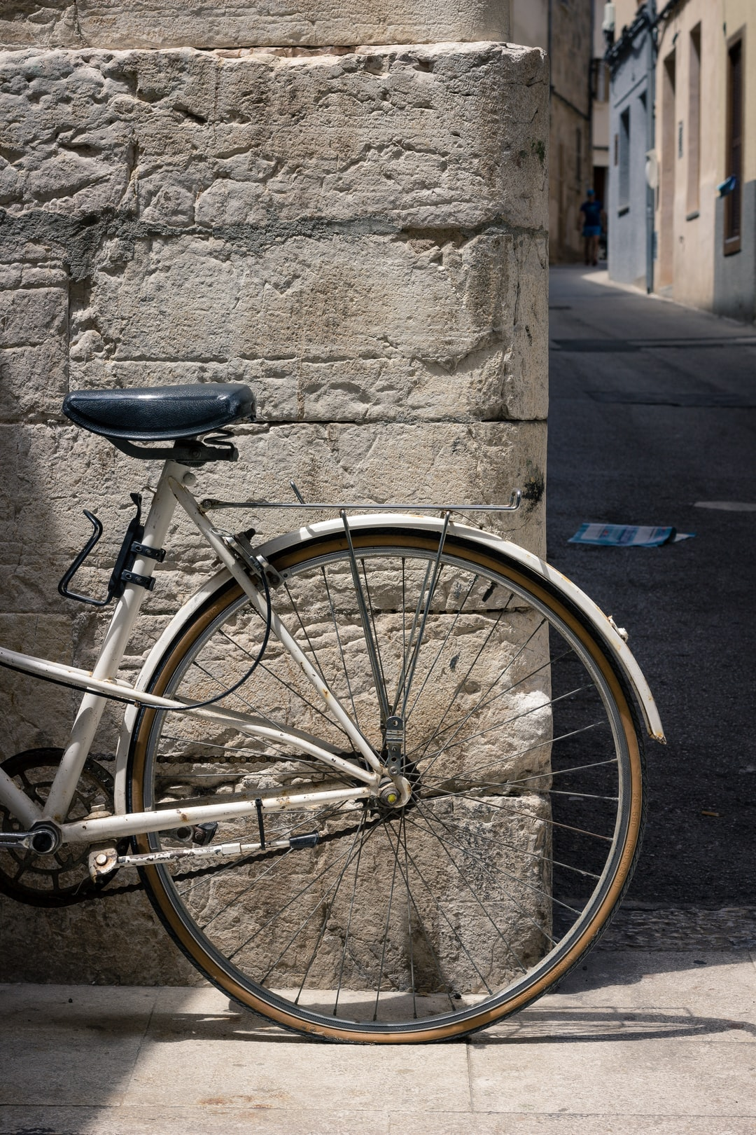 Walking through Alcudia old town during siesta time, the streets near empty and the shutters on home closed. No cars parked, taking up valuable space, however this bike was placed here, no padlock or not chained to anything. Simply placed against a sandstone wall.