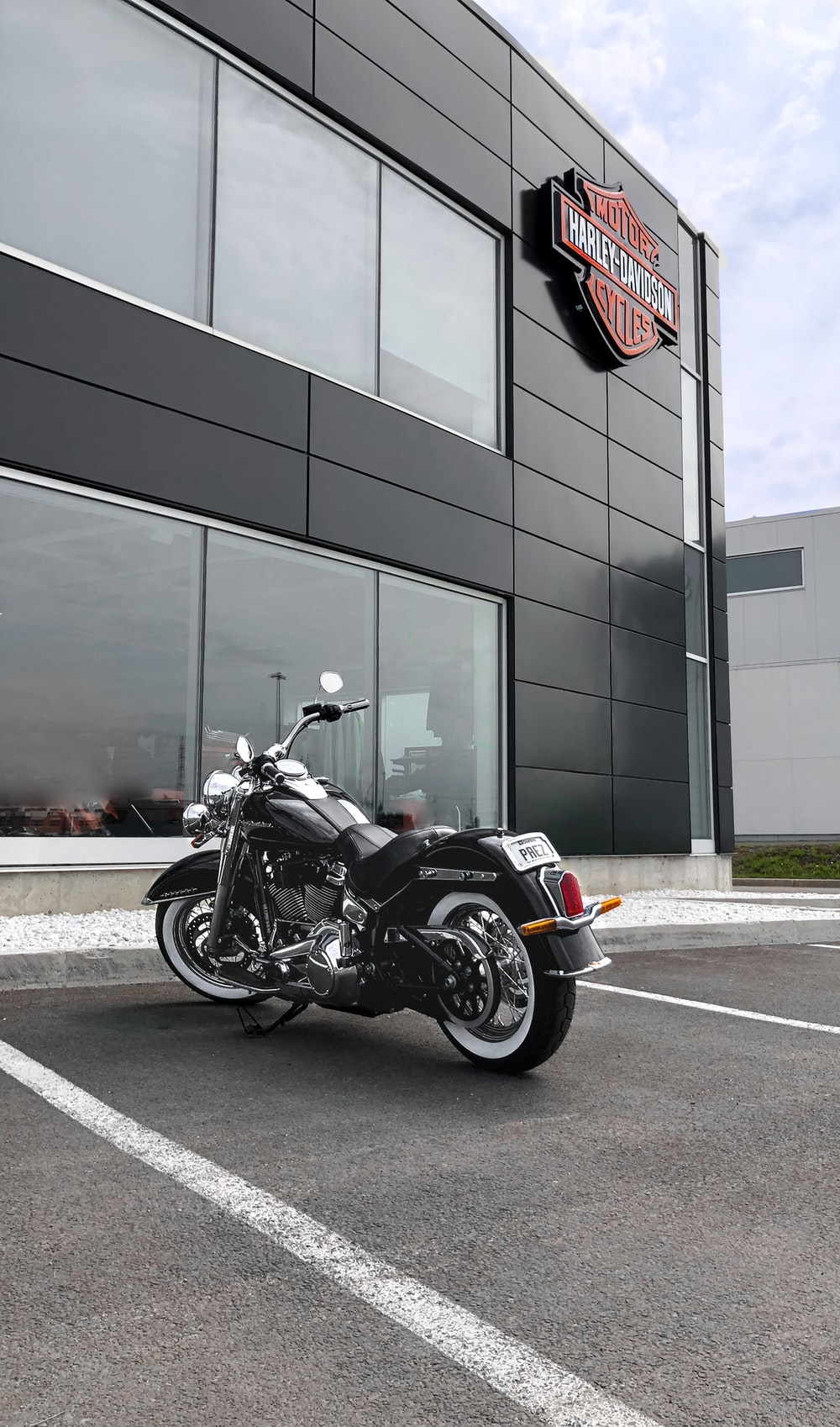 black cruiser motorcycle parked beside store