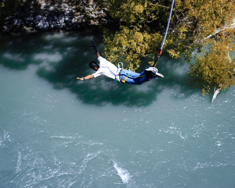 man bungee jumping