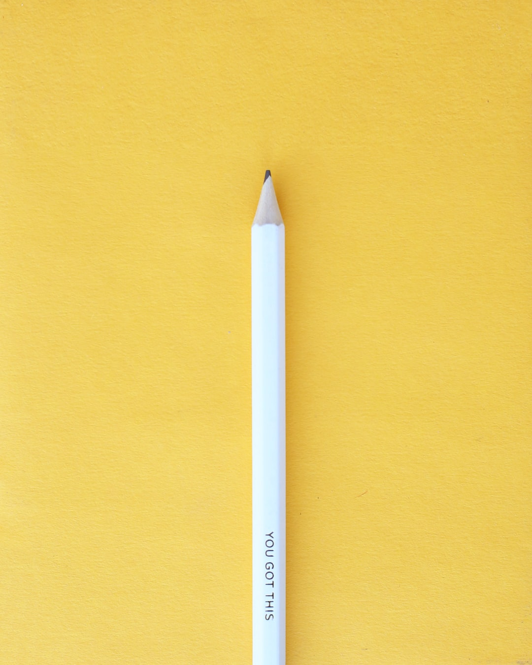 white pencil with a yellow background - you got this
