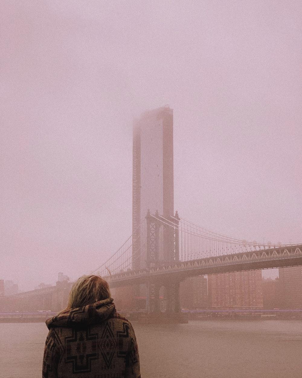 woman facing bridge