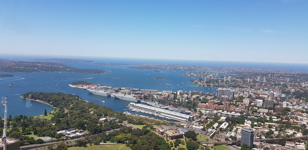aerial photo of city beside sea\