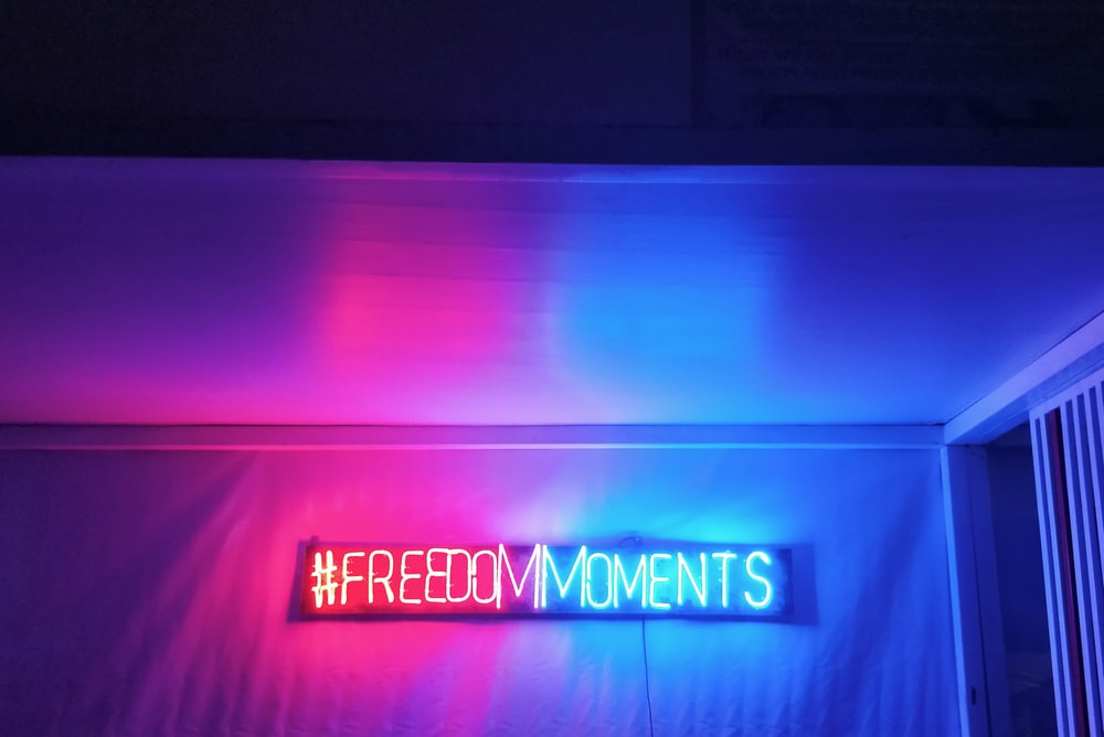 freedom moments neon light signage