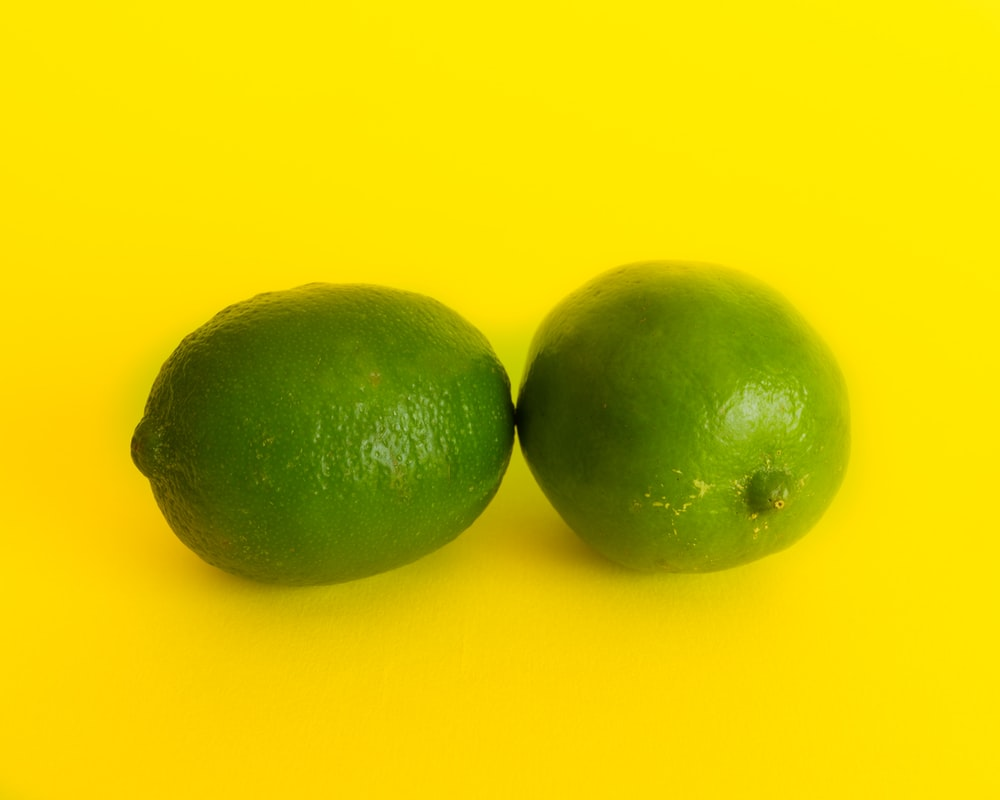 two lime fruits