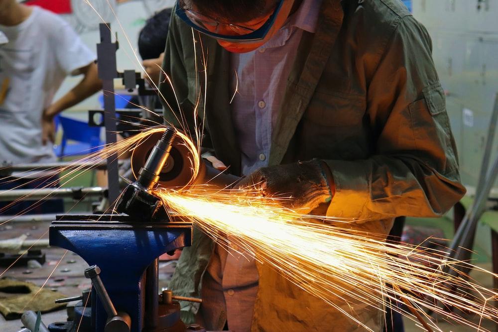 man cutting iron