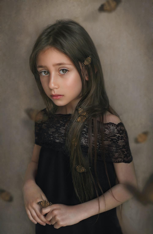 girl wearing black off-shoulder dress