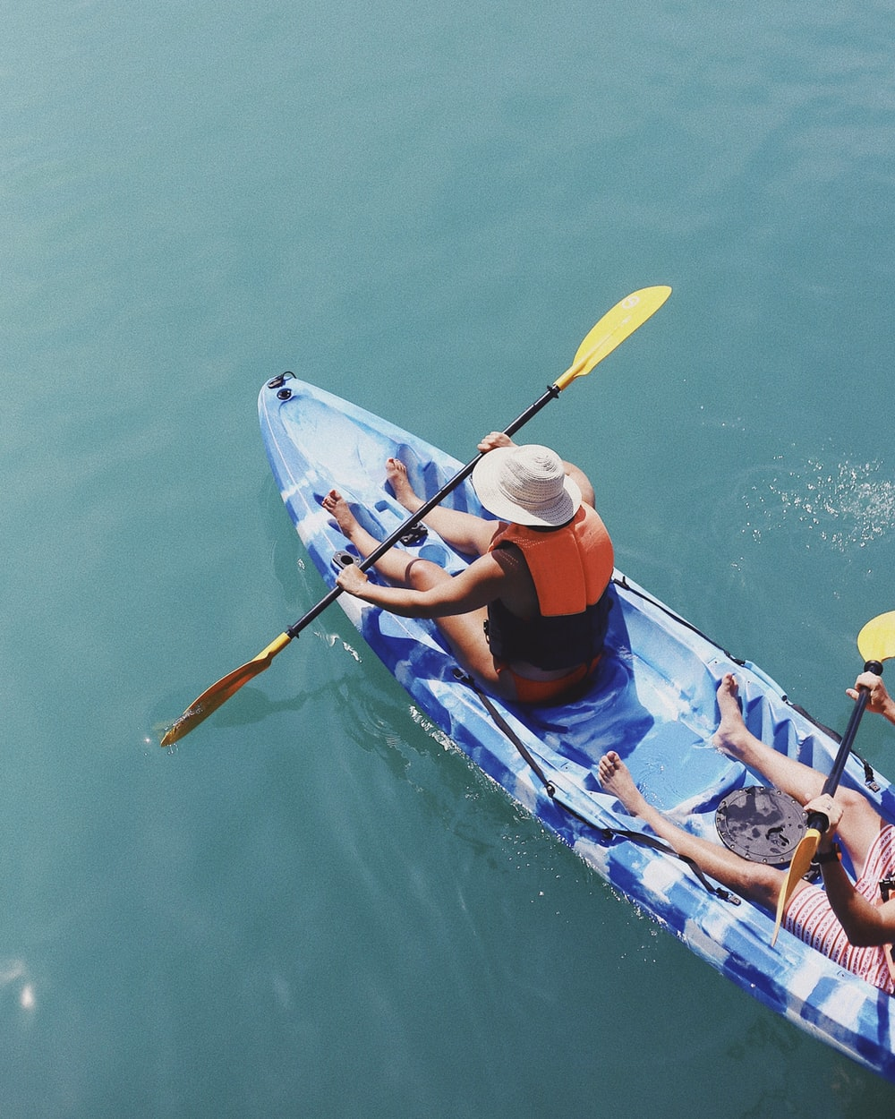 person holding paddle in boat