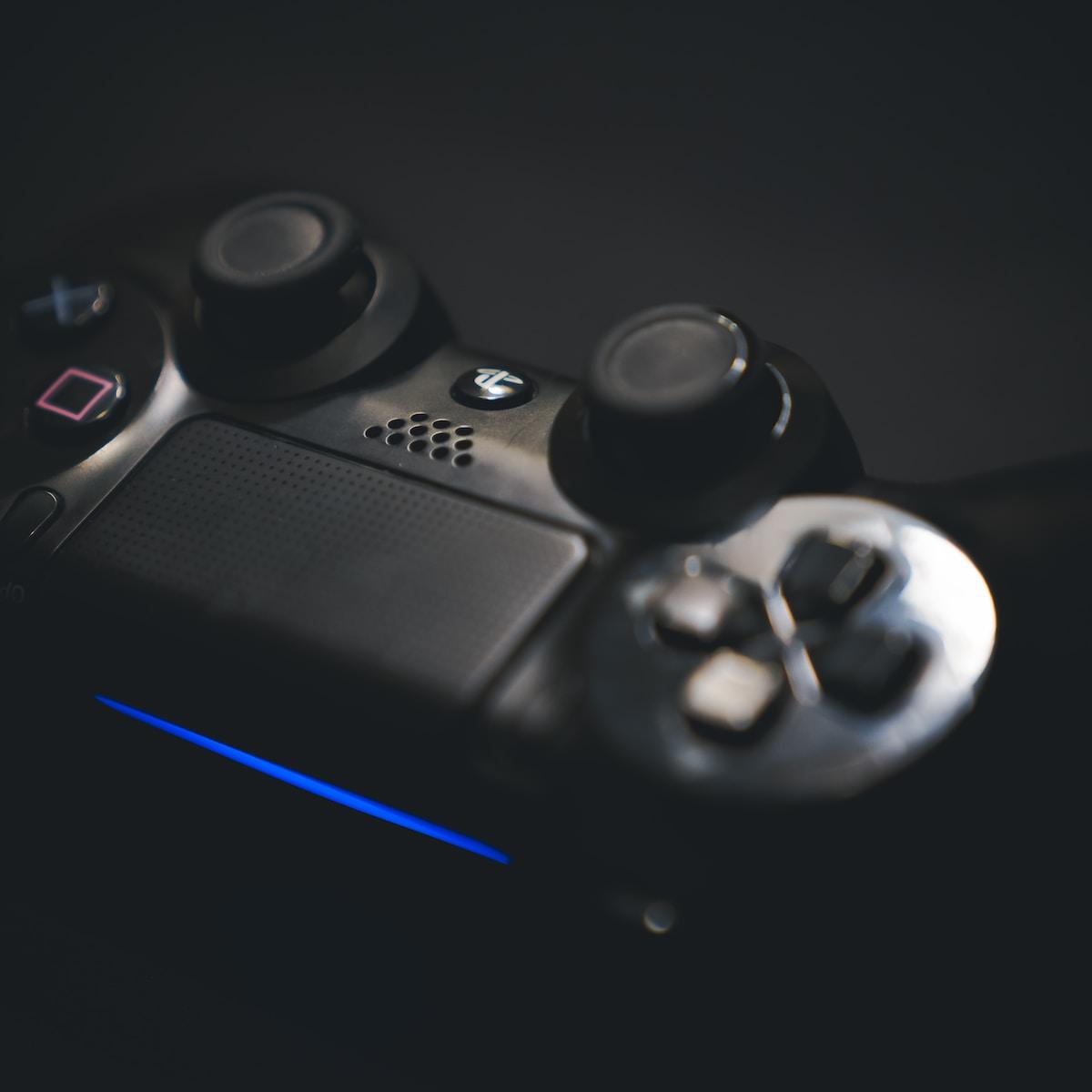 black Playstation game controller