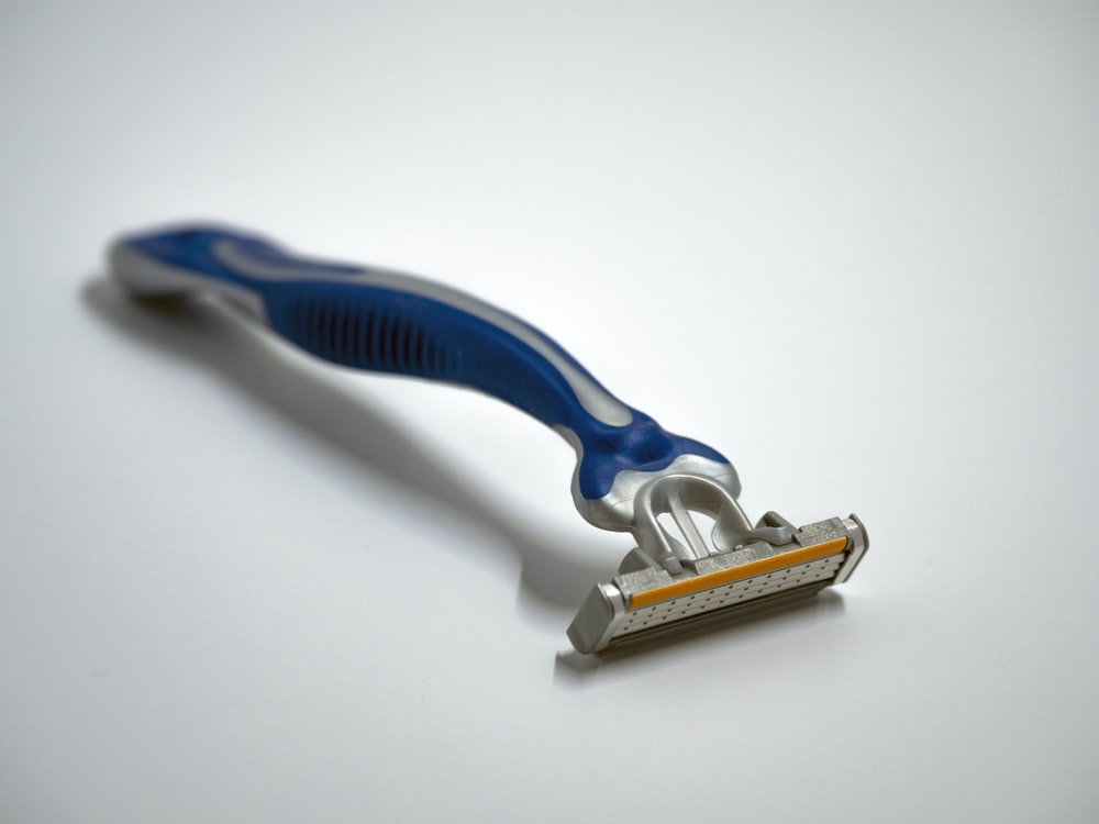 blue and silver Gillette razor