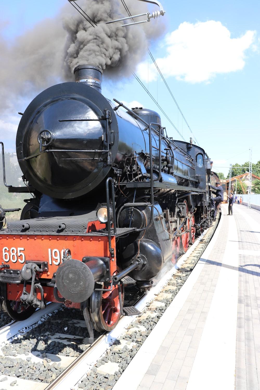 black and orange train on track
