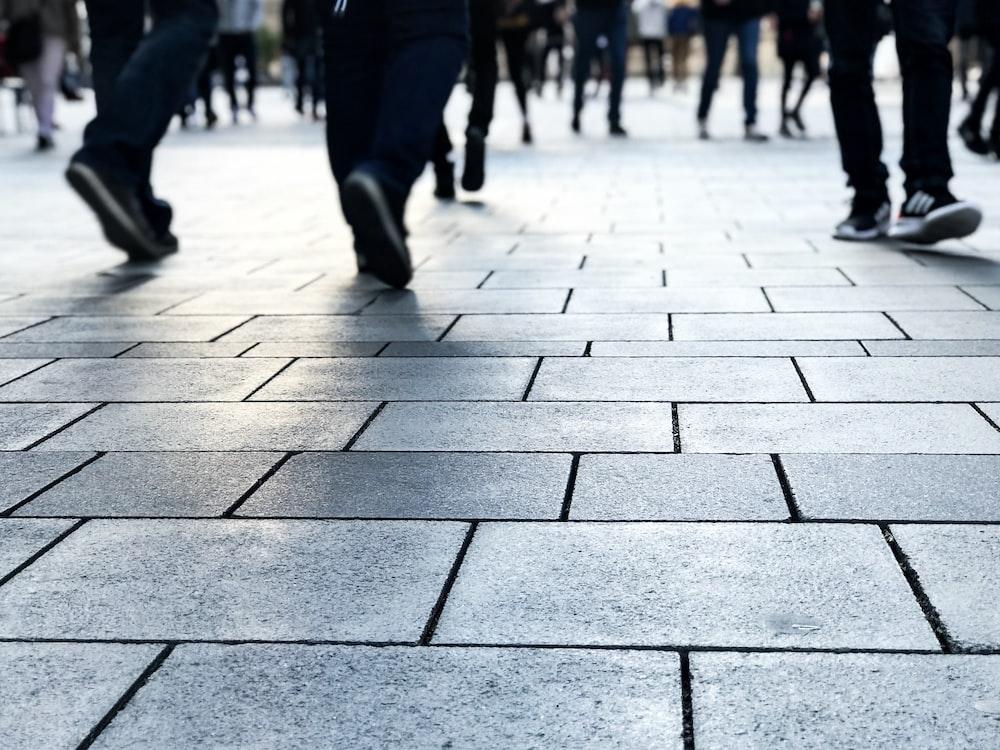 people walking on gray floor