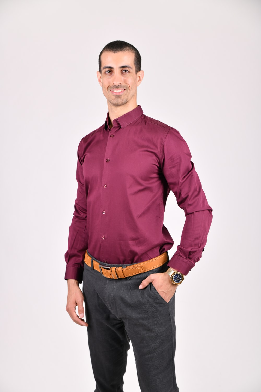 man wearing purple dress shirt
