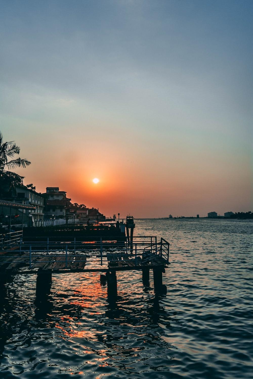 brown dock during golden hour
