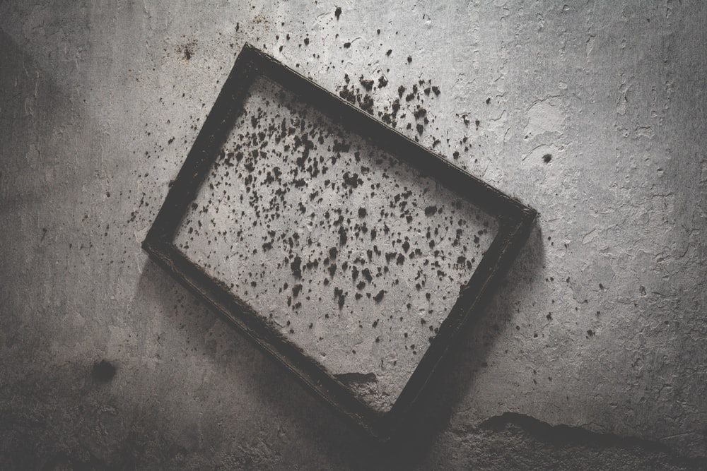 brown wooden frame on gray concrete surface