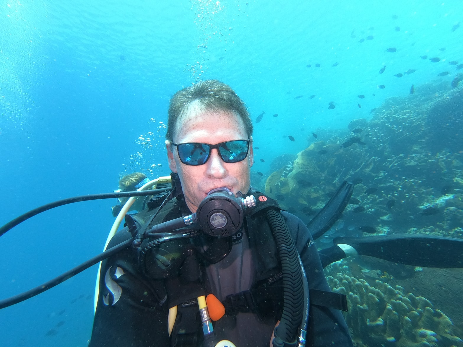man wearing scuba regulator while underwater