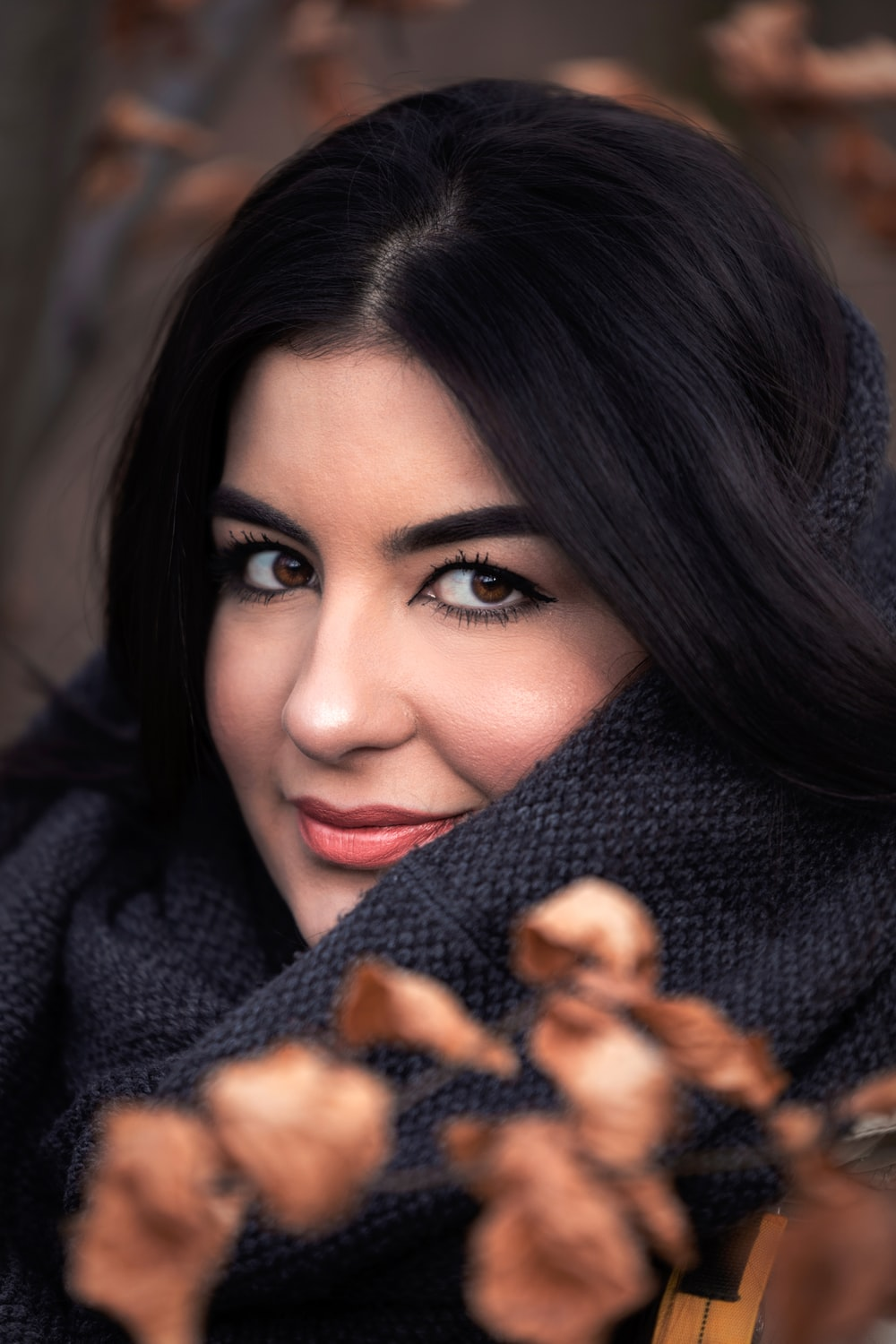 smiling woman wearing scarf close-up photography