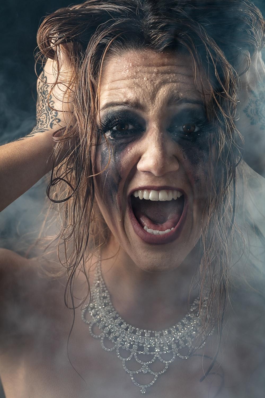 woman shouting and touching hiar