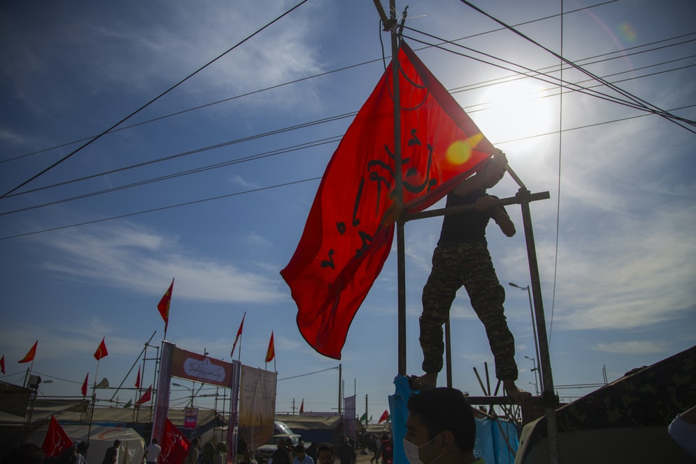 man holding red flag