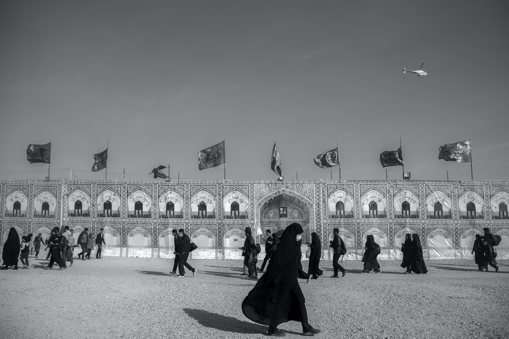 grayscale photo of woman wearing abaya