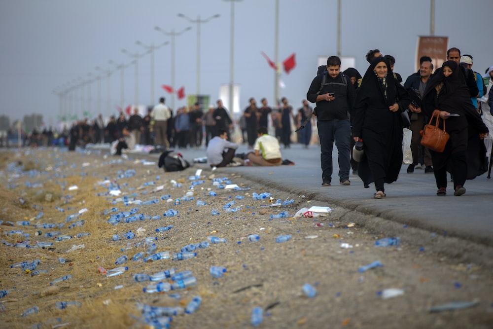 woman wearing black abaya dress walking on street during daytime