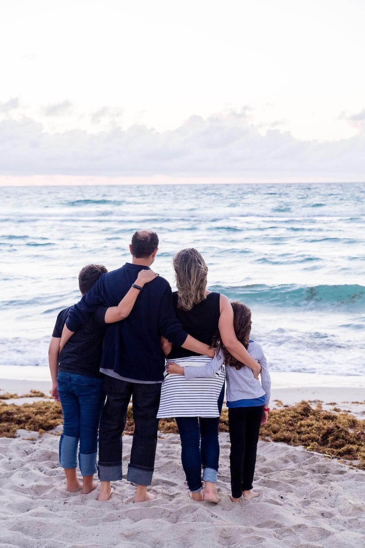 a family of four on a beach