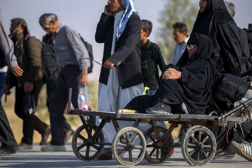 woman on a metal cart