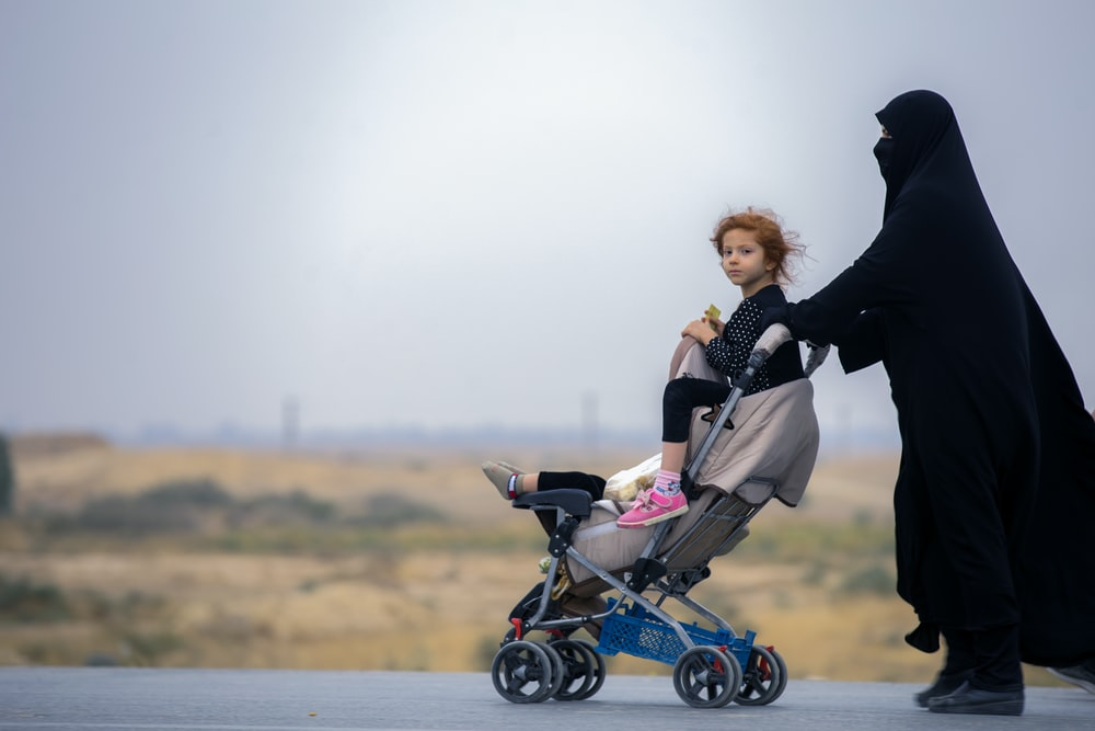 woman carrying stroller