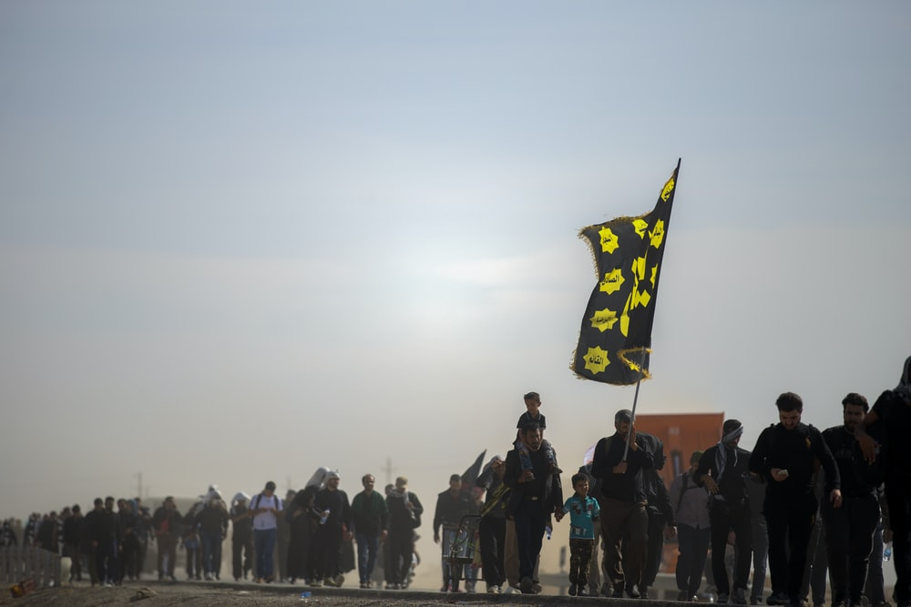person holding white and yellow flag