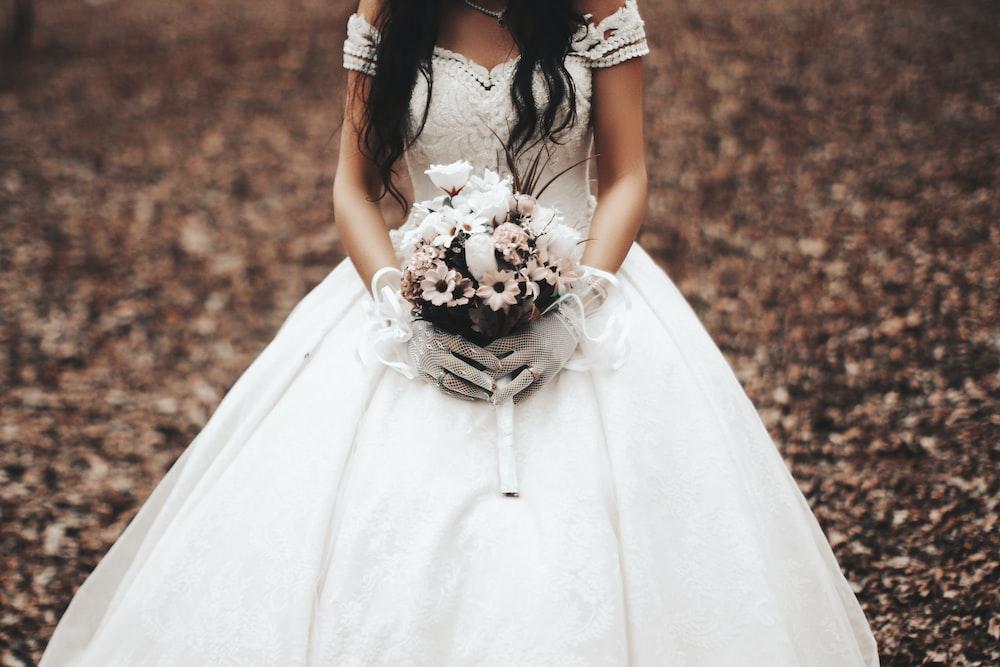 woman wearing white off-shoulder dress