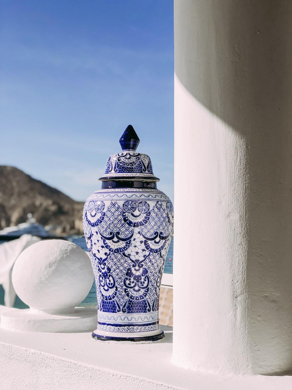 white and blue ceramic floral floor vase