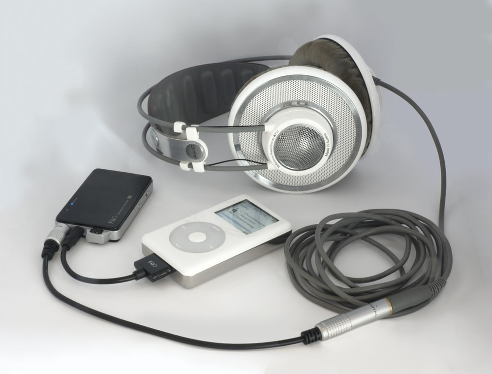 white and silver headphones