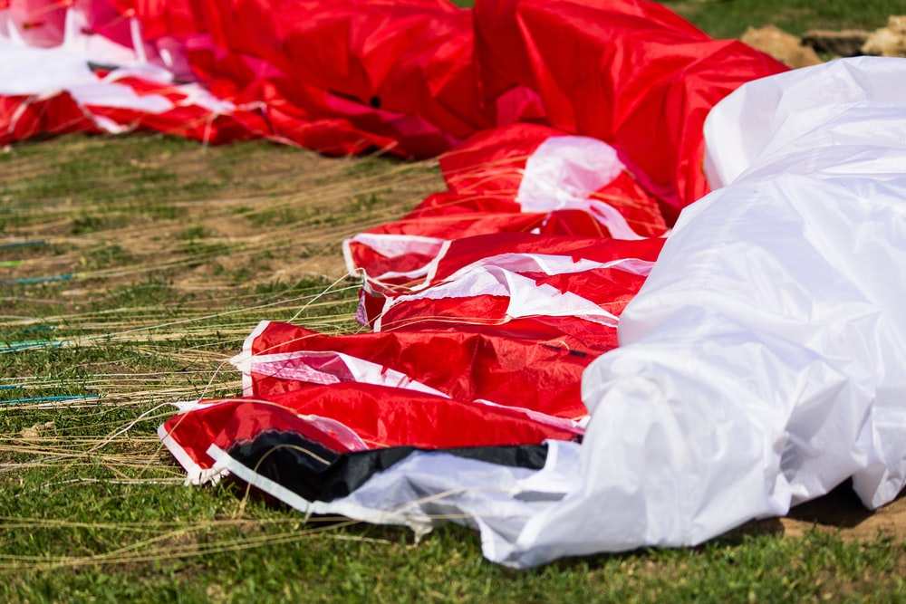 red and white parachute on grass