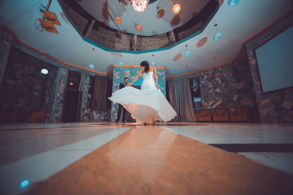 woman in white dancing in a ballroom