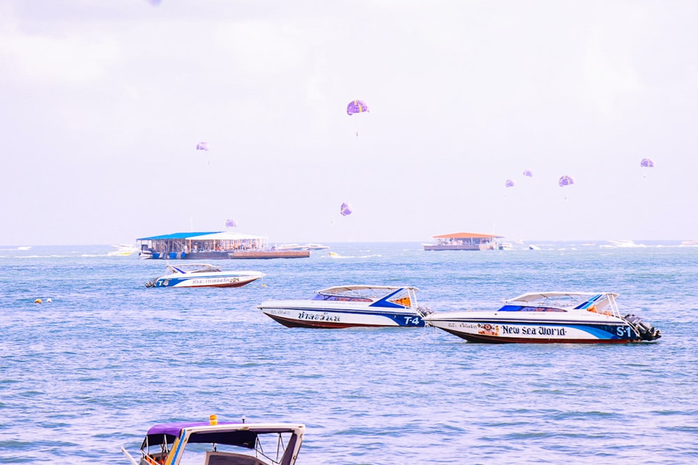 assorted boats on body of water during daytime