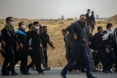 people walking during daytime iranian teams background