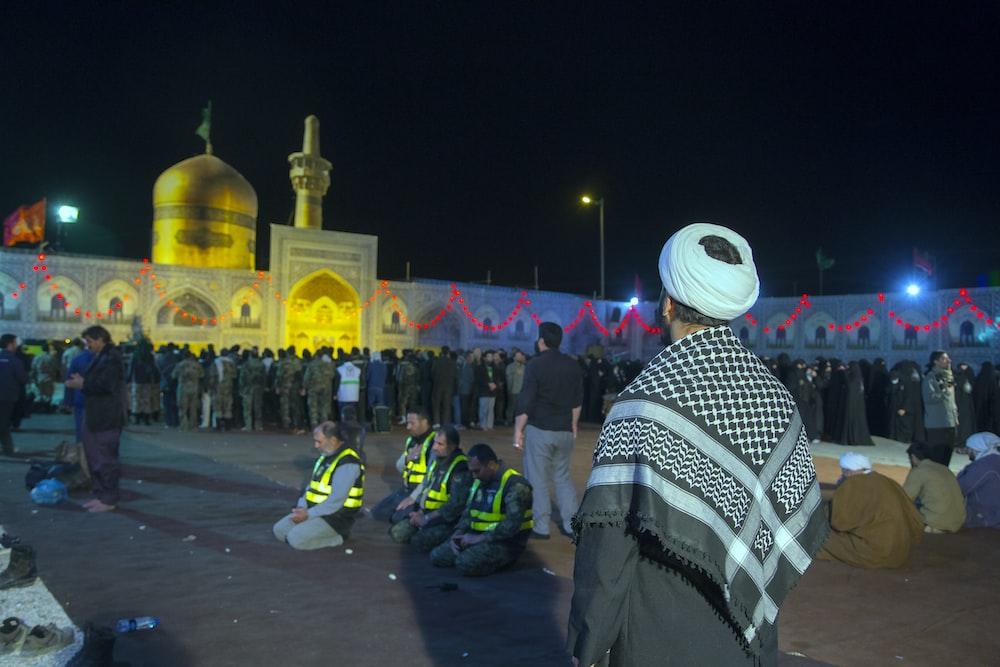 landscape photo of Muslims praying
