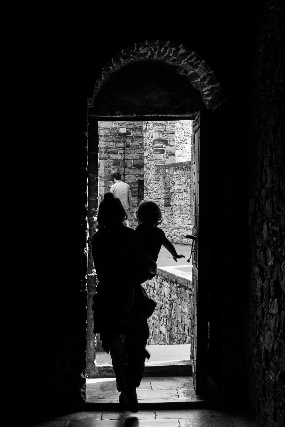 silhouette of woman holding baby