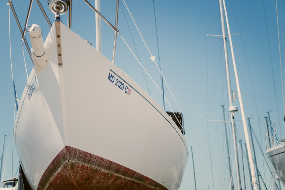 white sailboat at the dock during daytime