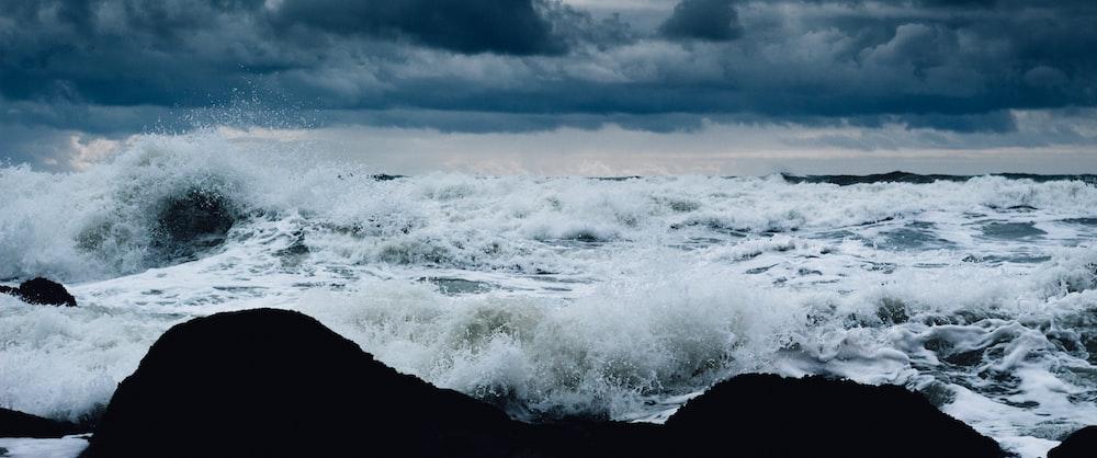 ocean wave crashing on island