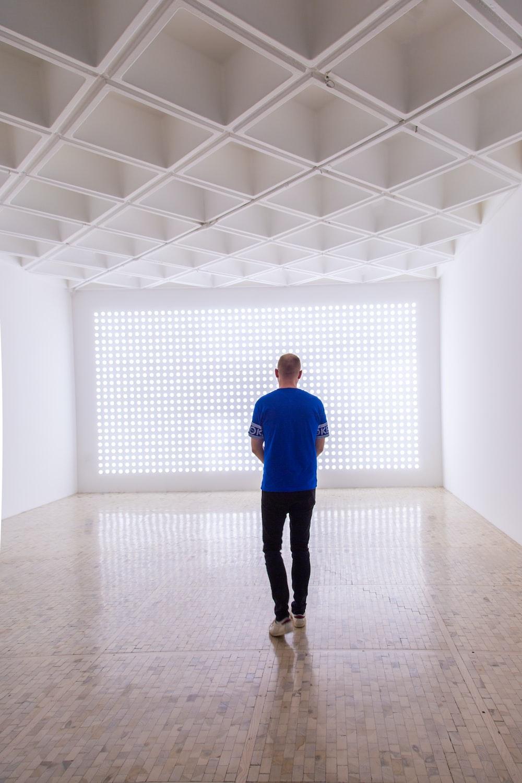 man standing inside room