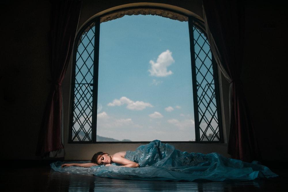 woman lying beside window