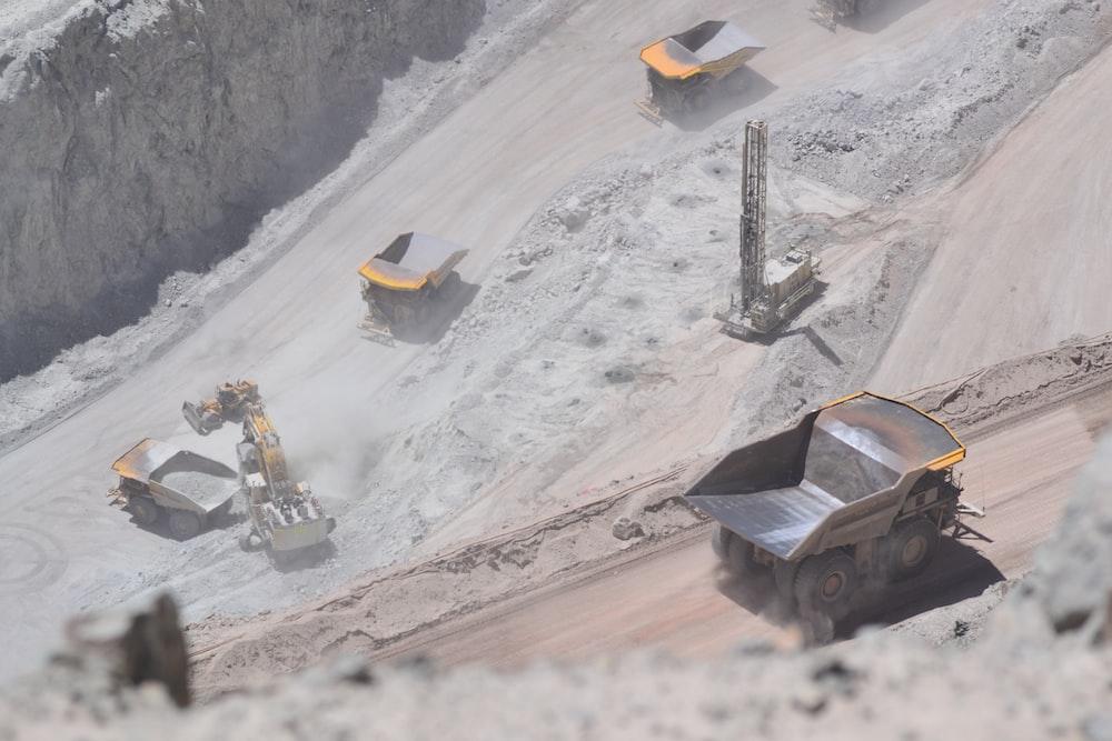 yellow heavy equipment on mountain