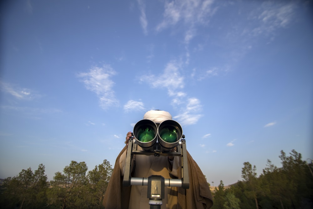 brown and grey binoculars