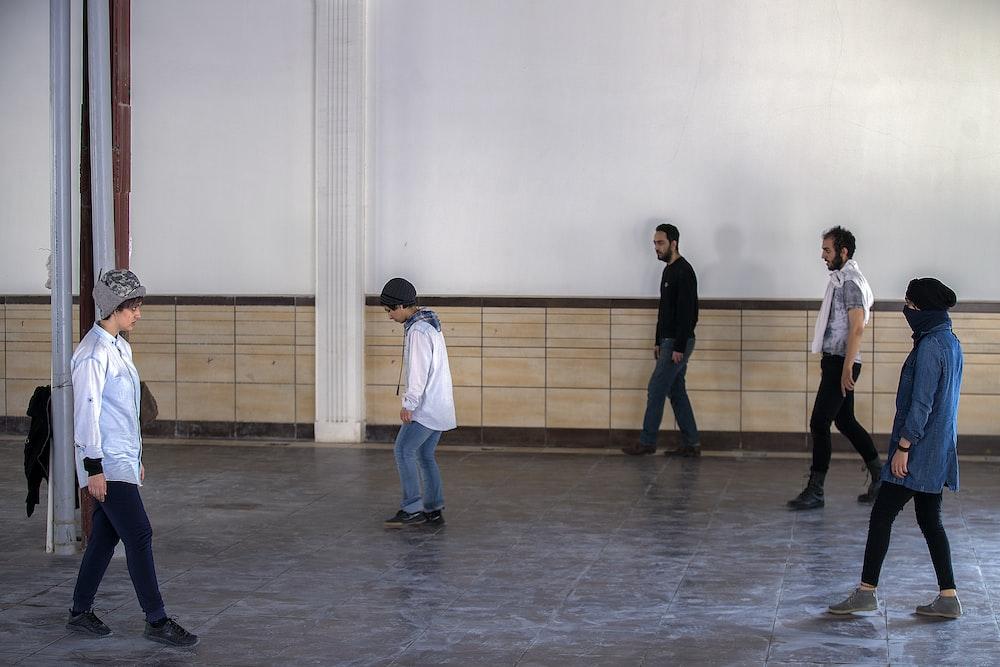 five men dancing at the studio