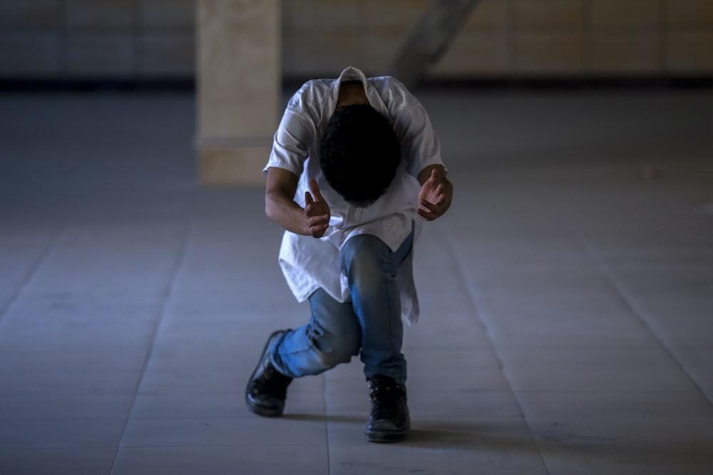 boy dancing on empty room