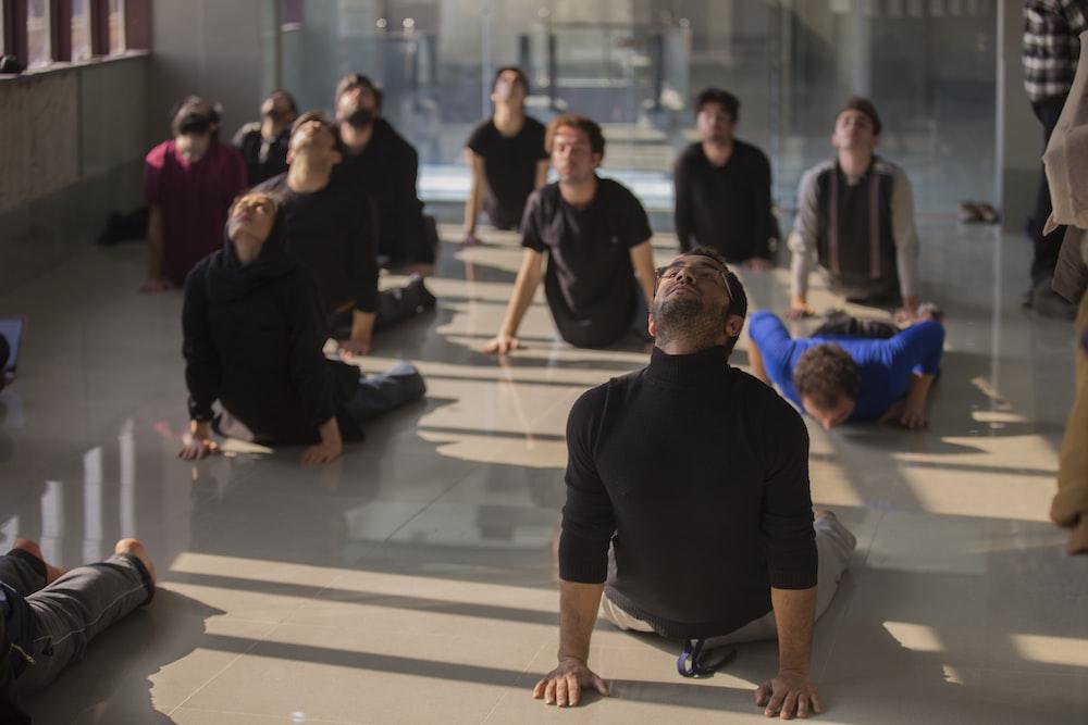 people doing exercise on floor